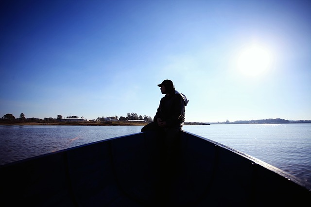 A guy in a fishing boat